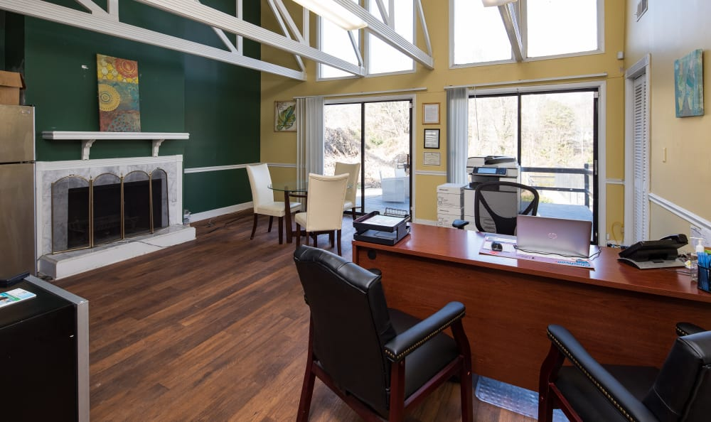 Leasing office with large windows and wood-style flooring at Premier Apartments in Austell, Georgia