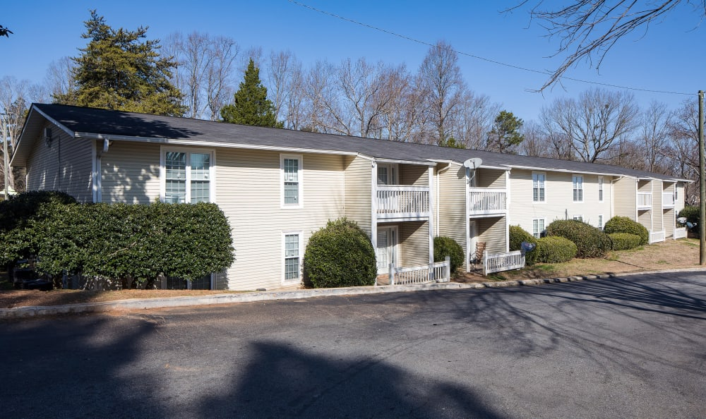 Beautiful exterior with plenty of parking at Premier Apartments in Austell, Georgia
