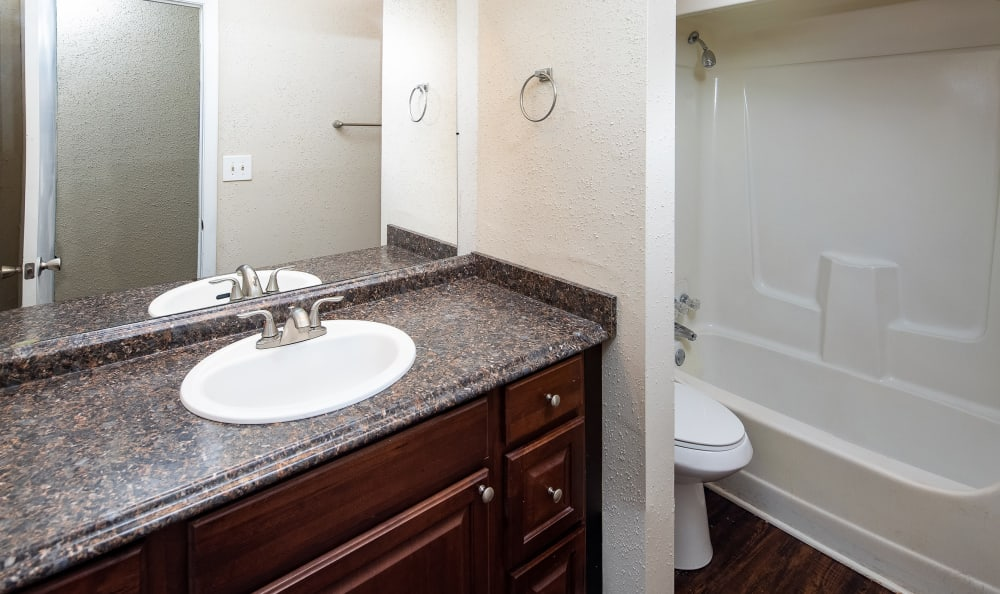 Bathroom with a large vanity mirror and circular tub at Premier Apartments in Austell, Georgia*