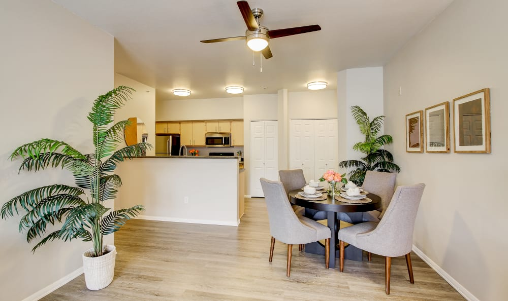View of the dining and kitchen areas from a model home's living area at River Trail Apartments in Puyallup, Washington