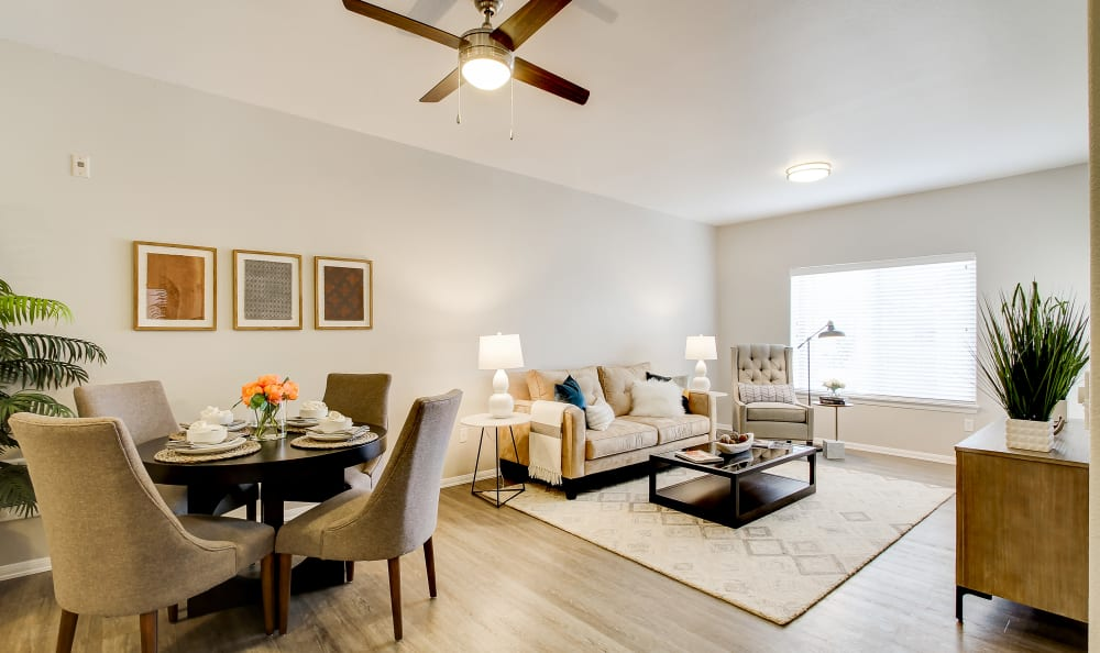 Ceiling fan and hardwood-style floors in a model home's living area at River Trail Apartments in Puyallup, Washington