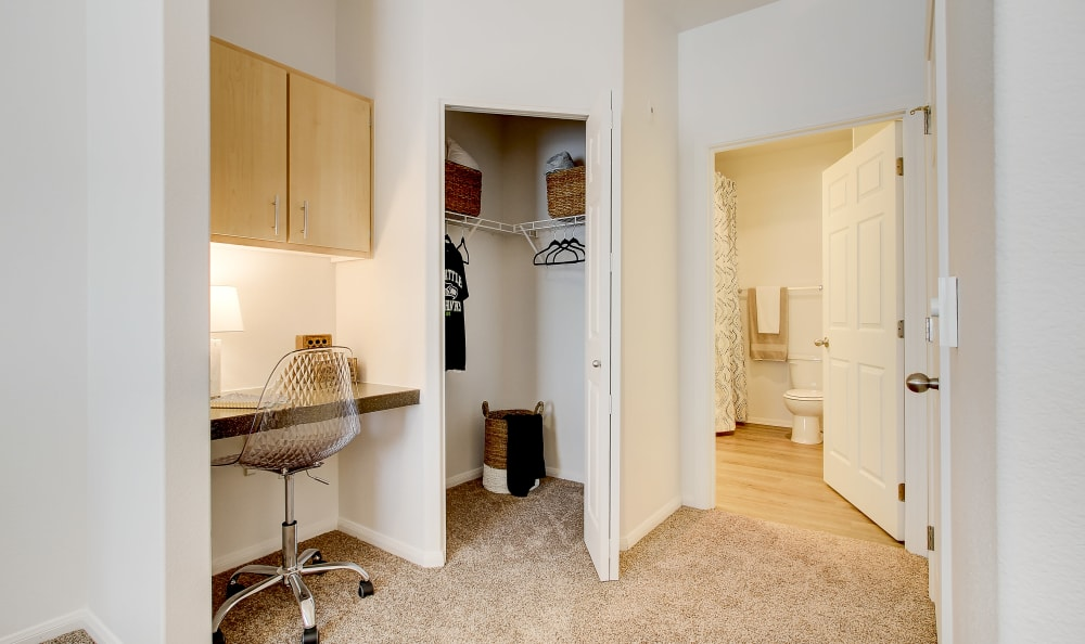 Study nook and walk-in closet in the bedroom of a model home at River Trail Apartments in Puyallup, Washington