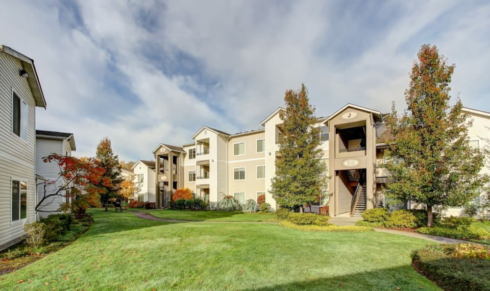 Well-manicured lawn outside resident buildings at River Trail Apartments in Puyallup, Washington