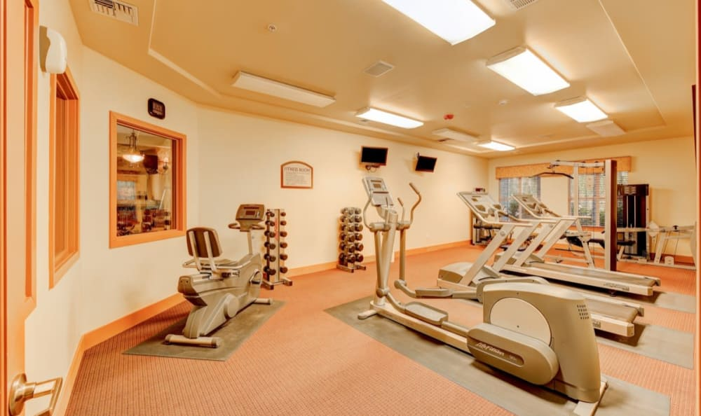 Well-equipped onsite fitness center at River Trail Apartments in Puyallup, Washington