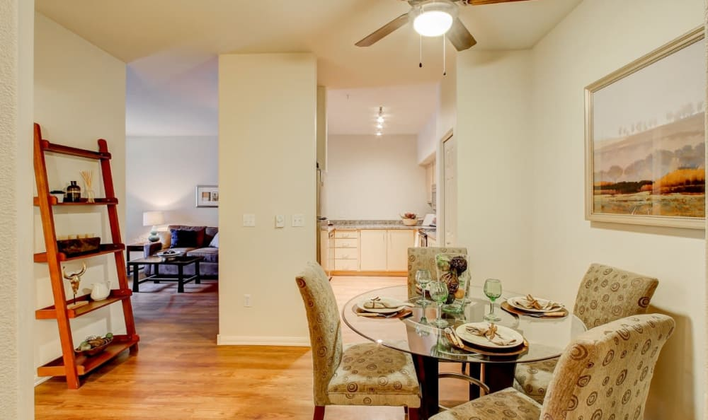 Partial view of the kitchen and living areas from the dining space in the open-concept floor plan of a model home at Columbia Trails in Gresham, Oregon