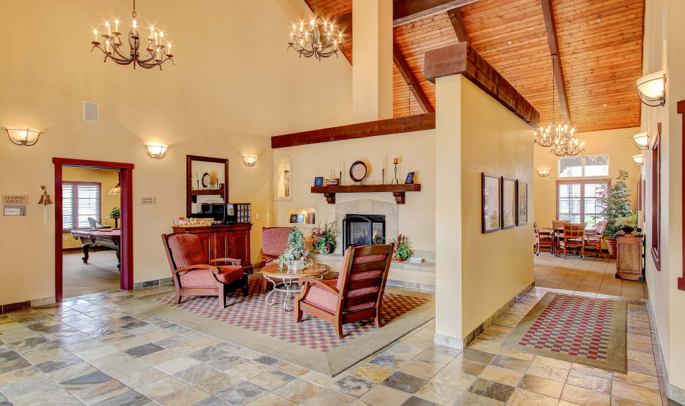 Comfortable seating in front of the fireplace in the clubhouse at Eaglewood Apartments in Woodland, California