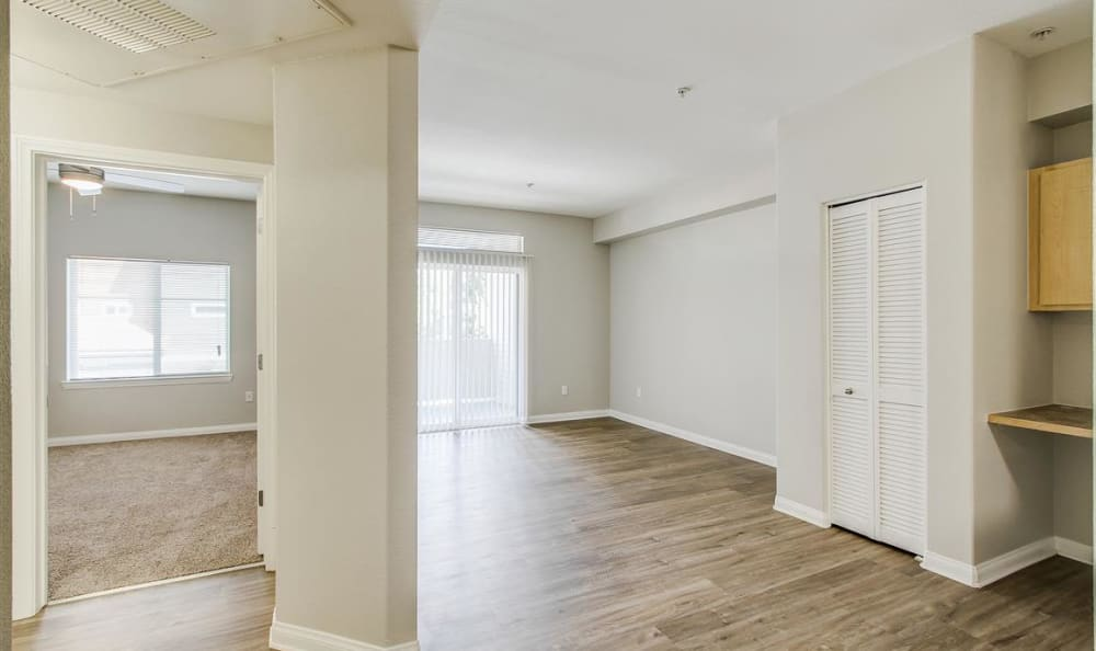 Spacious open-concept layout with hardwood floors and plenty of extra storage in an apartment home at Sierra Oaks Apartments in Turlock, California