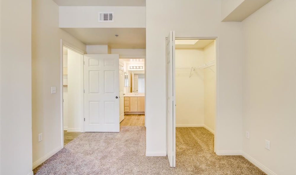 Large master bedroom with an en suite bathroom and walk-in closet in an apartment home at Sierra Oaks Apartments in Turlock, California