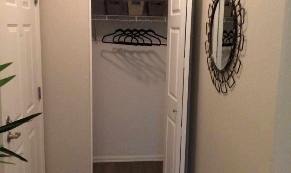 Closet space in a model home at Eaglewood Apartments in Woodland, California