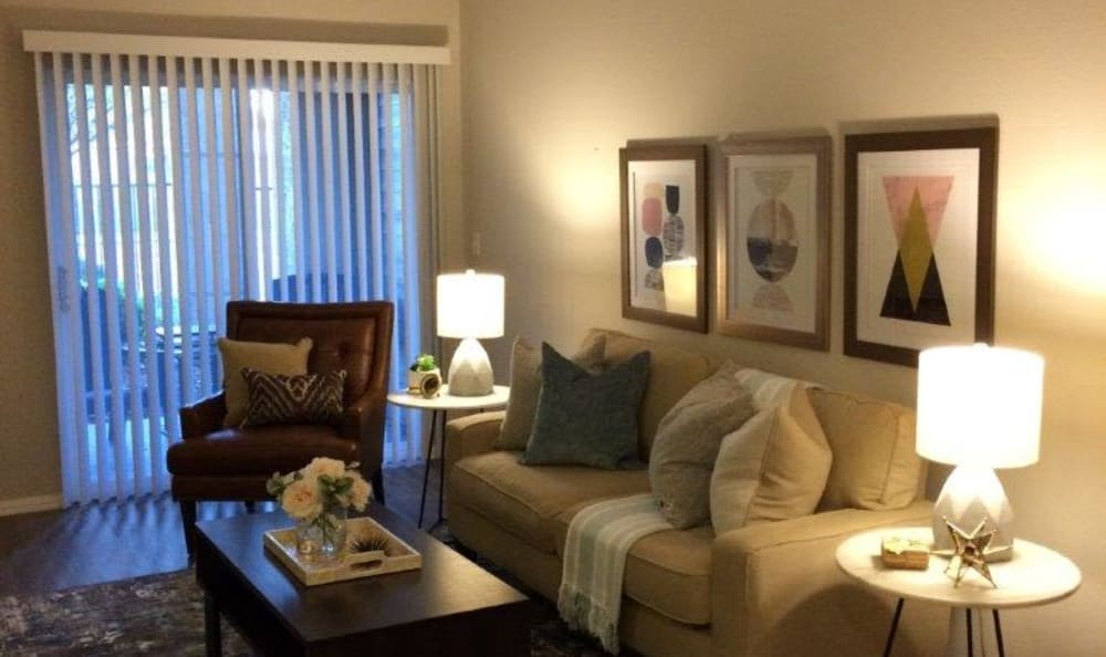 Living room in a model home at Eaglewood Apartments in Woodland, California