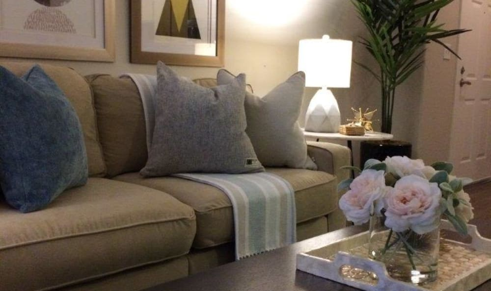 Comfortable couch in the living area of a model home at Eaglewood Apartments in Woodland, California