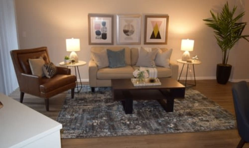 Well-decorated living space in a model home at Eaglewood Apartments in Woodland, California