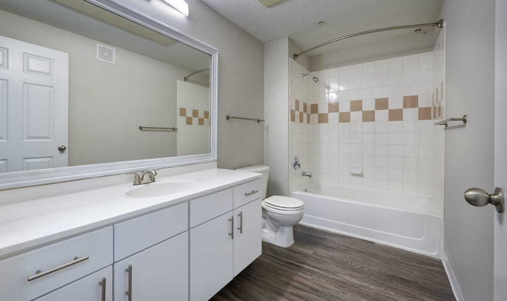 Renovated White Bathroom and Tub at Bear Valley Park in Denver, Colorado
