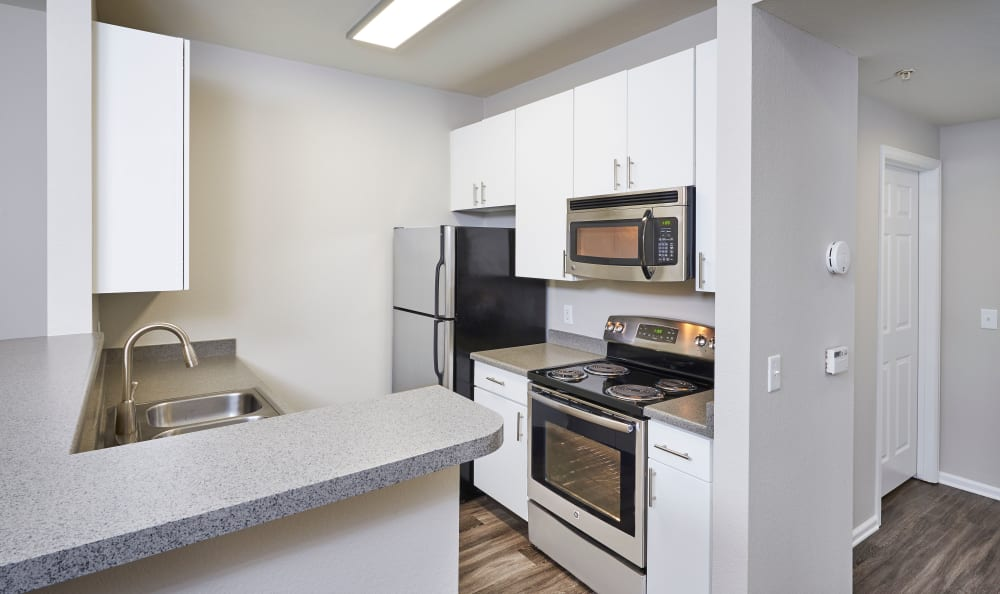 White renovated kitchen with stainless steel appliances