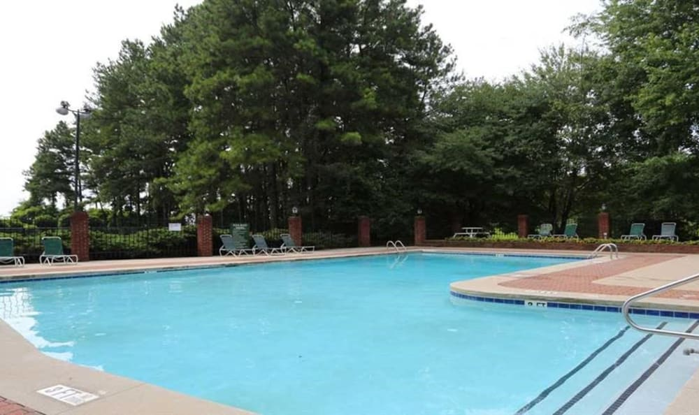 Large swimming pool with a sundeck at 300 Riverside in Austell, Georgia