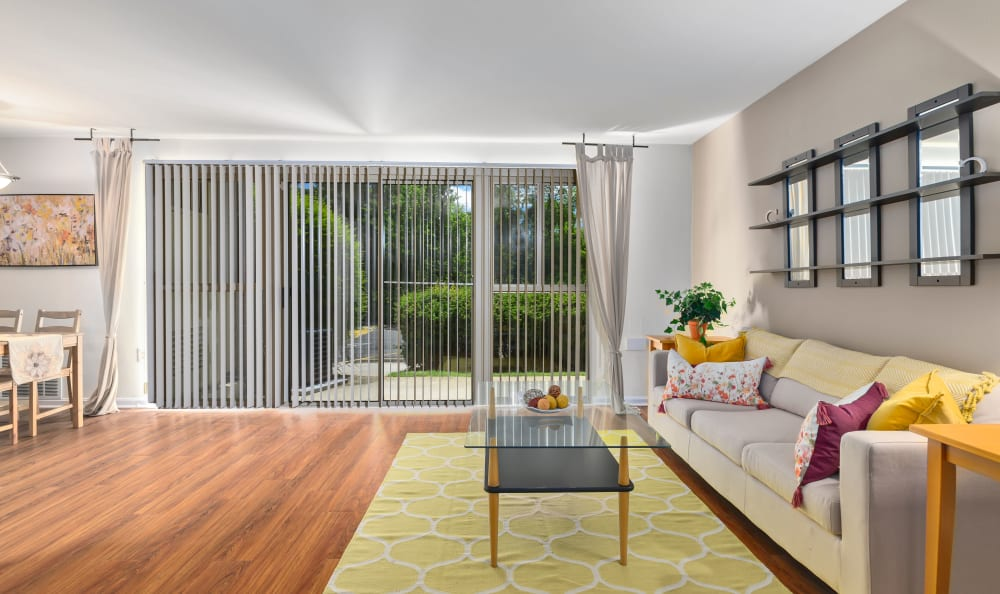 Spacious living room with wood-style flooring at Capital Crossing in Suitland, Maryland