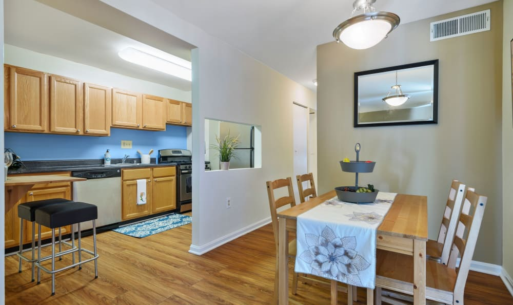 Kitchen with a pass-through window at Capital Crossing in Suitland, Maryland