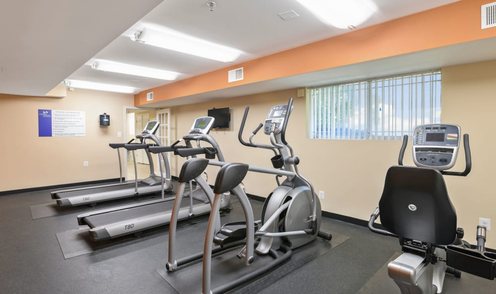 Fitness center with individual workout stations at Capital Crossing in Suitland, Maryland
