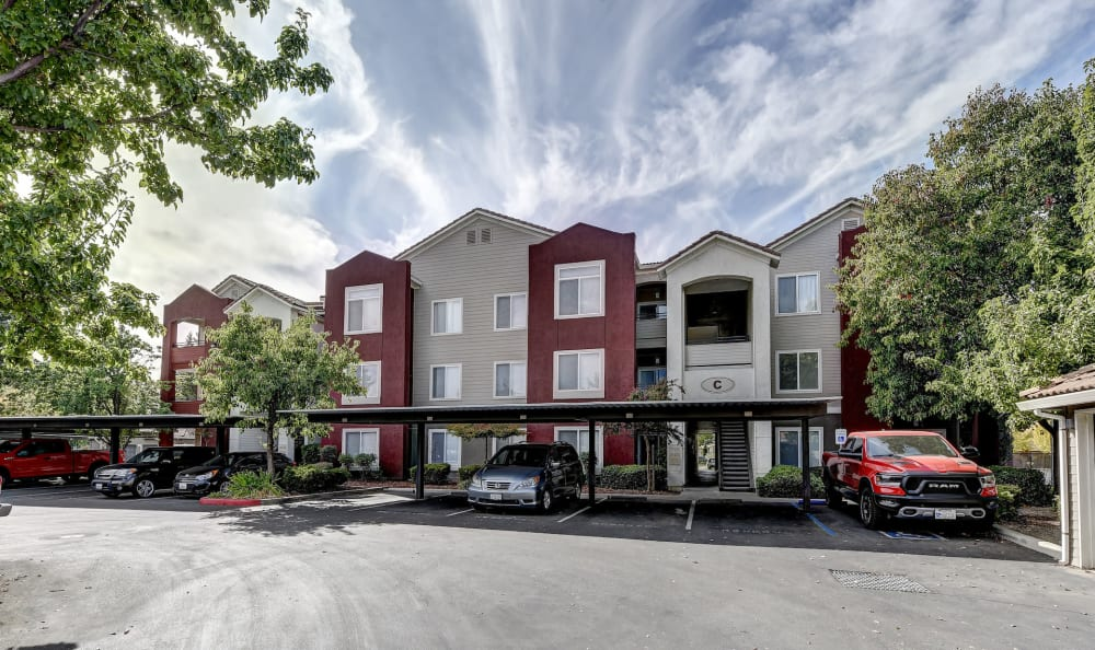 Exterior view of apartments and parking at Eaglewood Apartments in Woodland, California