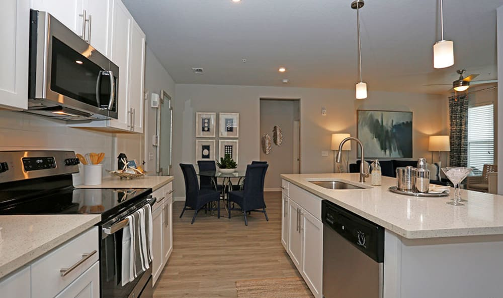 Open-concept floor plan with the kitchen overlooking the dining room at Vue at Belleair in Clearwater, Florida