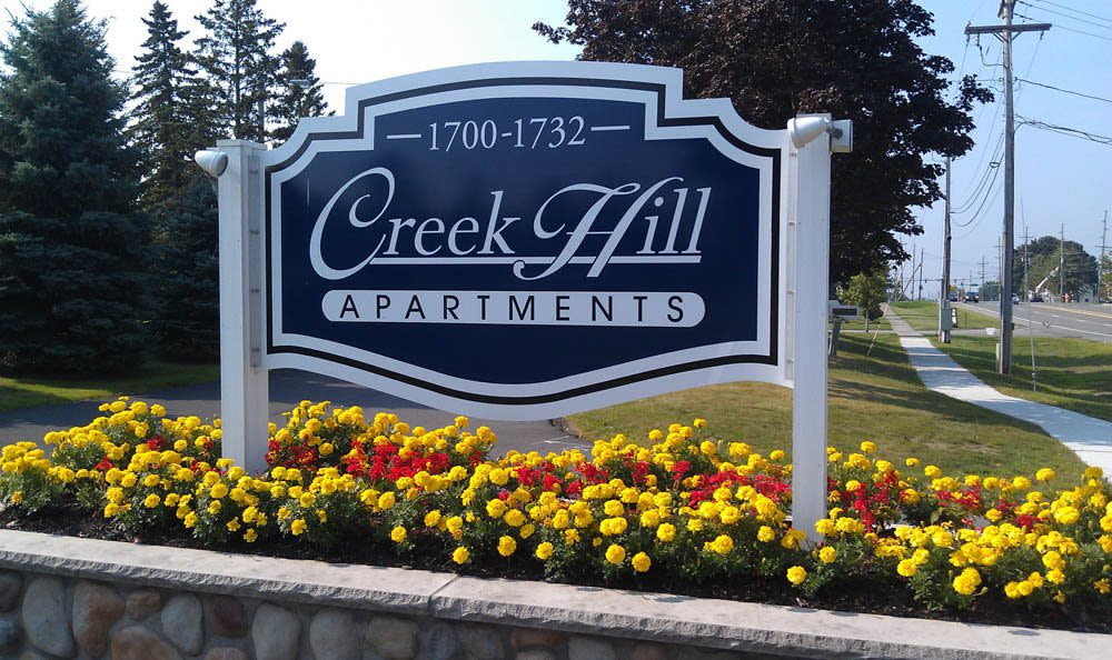 Sign to Creek Hill Apartments in Webster, New York