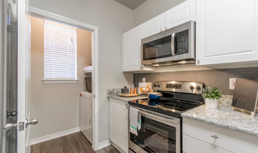 Kitchen and laundry room at 2803 Riverside in Grand Prairie, Texas