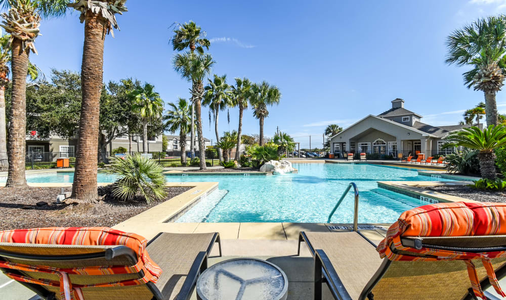 Comfortable sunchairs around the pool at Azure Apartments in Corpus Christi, Texas