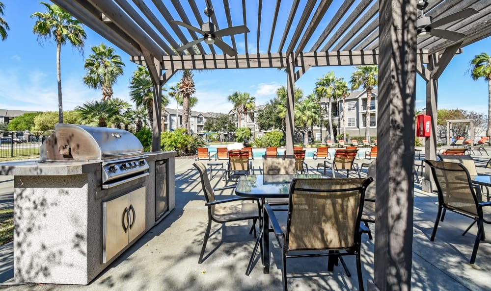 Outdoor kitchen and grills by the pool at Azure Apartments in Corpus Christi, Texas