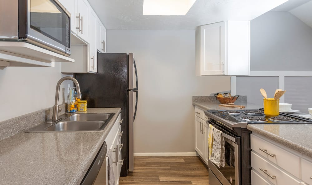 Windgate Apartments kitchen is equipped with stainless steel appliances