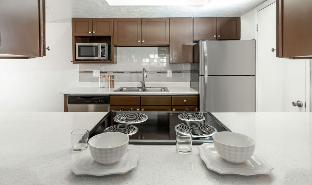 brown renovated Kitchen at Windgate Apartments in Bountiful, Utah