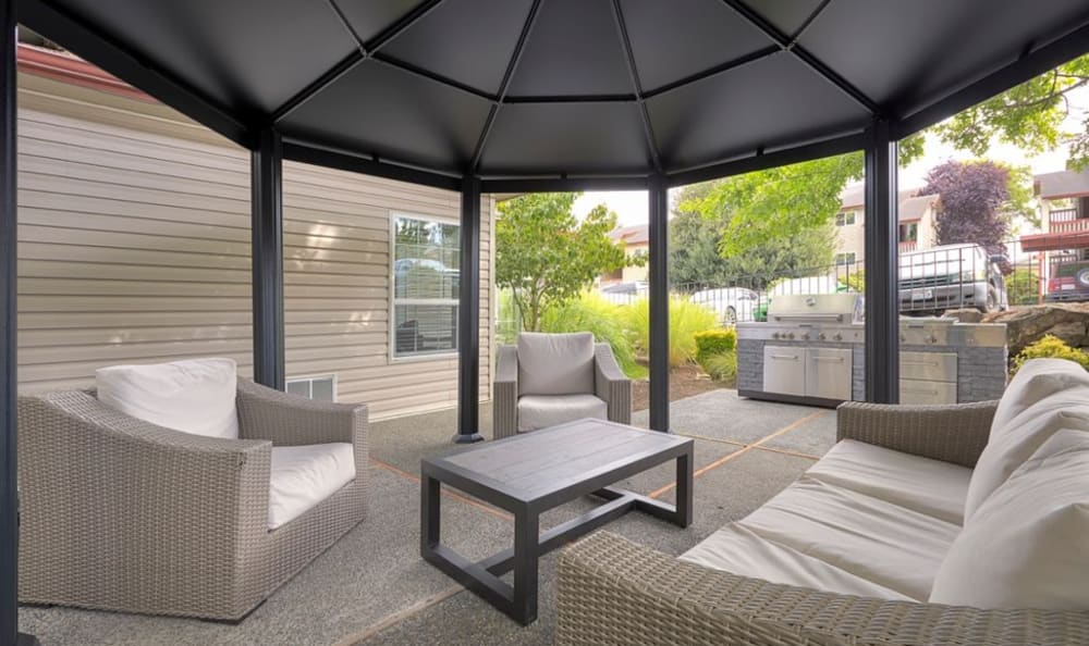 Outdoor Lounge & BBQ Area at Discovery Landing Apartment Homes in Burien, Washington