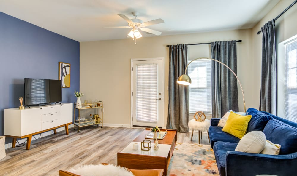 Spacious and well lit living room at Meridian Obici in Suffolk, Virginia
