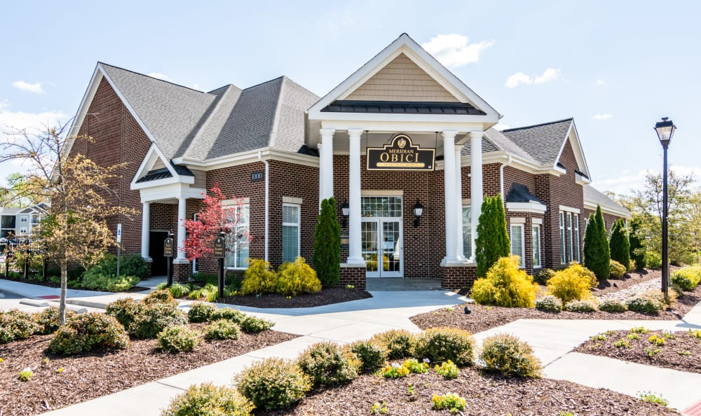 Landscaped resident clubhouse and leasing center at Meridian Obici in Suffolk, Virginia
