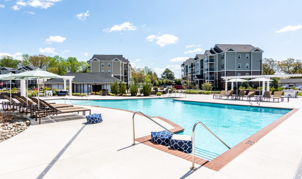 Swimming pool with a sundeck and lounge chairs at Meridian Obici in Suffolk, Virginia