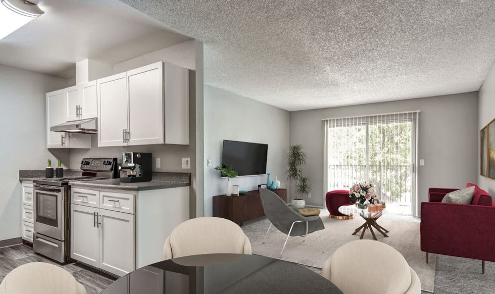 Kitchen and open spacious living room view at The Woodlands Apartments in Sacramento,CA