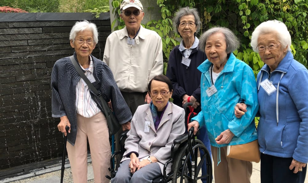 A group of residents posing for a picture near Nikkei Manor in Seattle, Washington