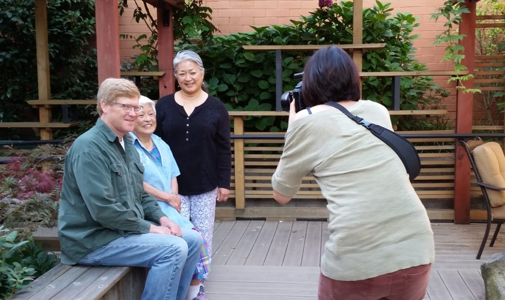 Residents getting their photo taken at Nikkei Manor in Seattle, Washington