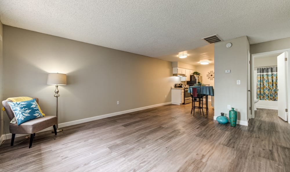 Living room and view of kitchen at Country Hills Apartment Homes in Corona, CA