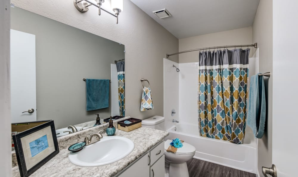 Bathroom featuring shower and bathtub at Country Hills Apartment Homes in Corona, CA