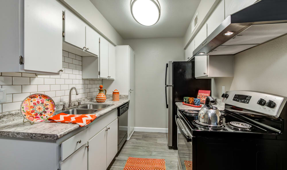 Kitchen with modern amenities at Country Hills Apartment Homes in Corona, CA