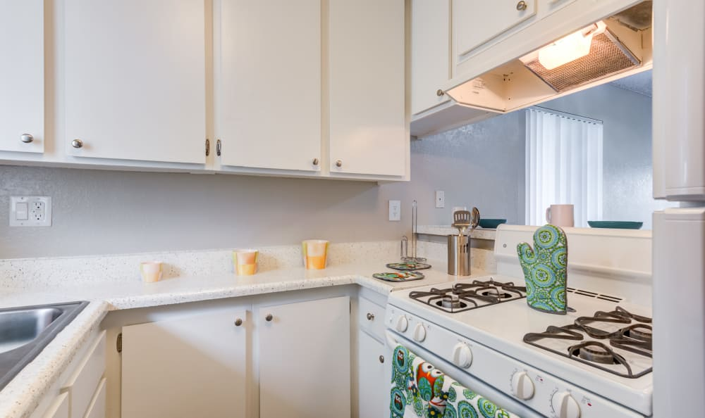Woodlands West Apartment Homes offers a Kitchen in Lancaster, California