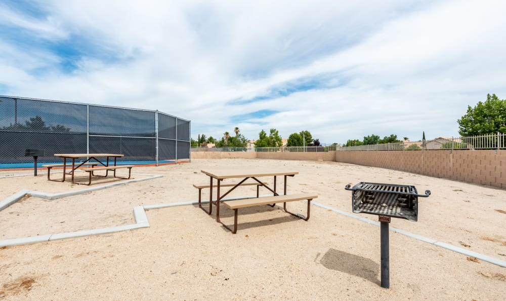 Outdoor seating at Woodlands West Apartment Homes in Lancaster, California