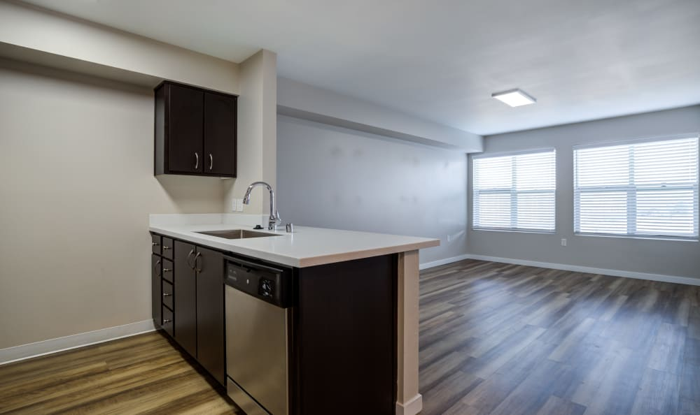 Open concept floor plan with hardwood floors at Lumen Apartments in Everett, Washington