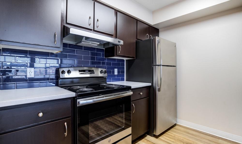 Beautiful kitchen with dark wood cabinets at Lumen Apartments in Everett, Washington
