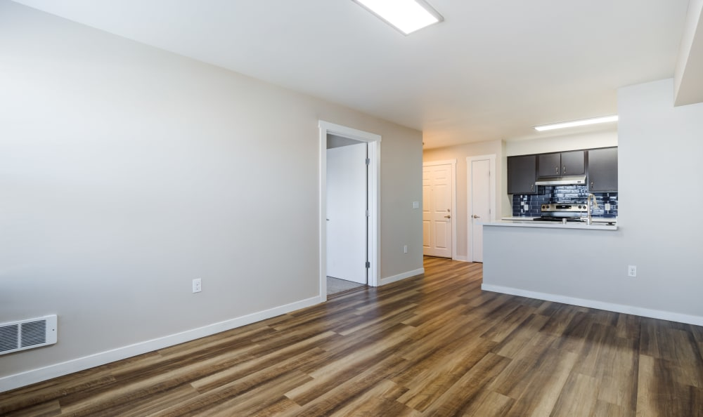 View of kitchen bar from living room at Lumen Apartments in Everett, Washington