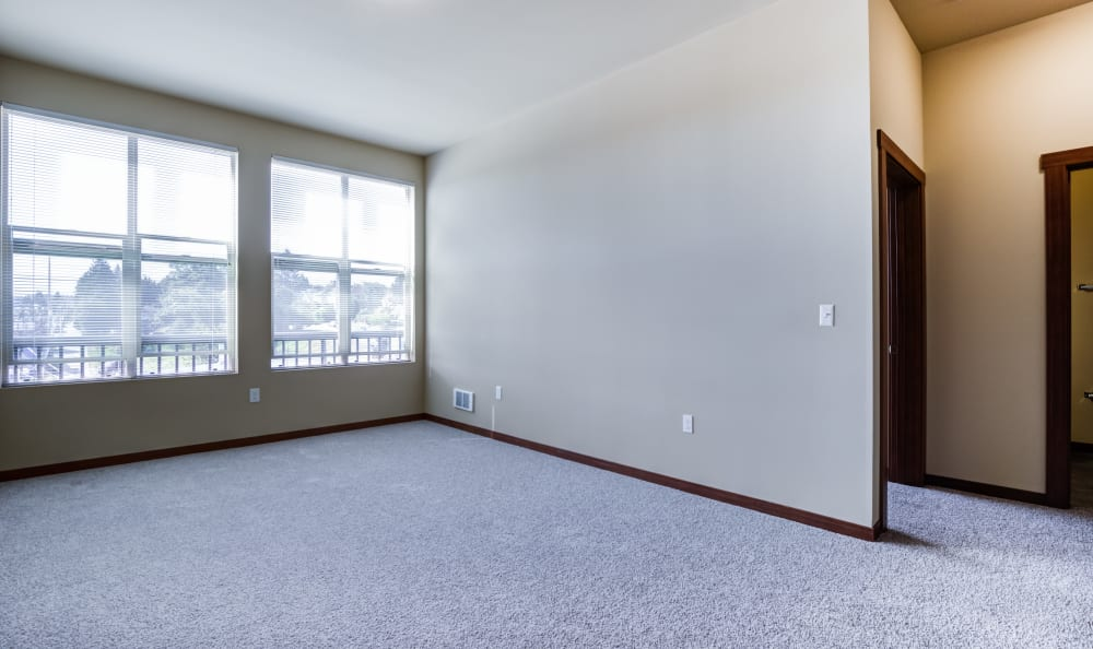 Well lit model living room at Lumen Apartments in Everett, Washington
