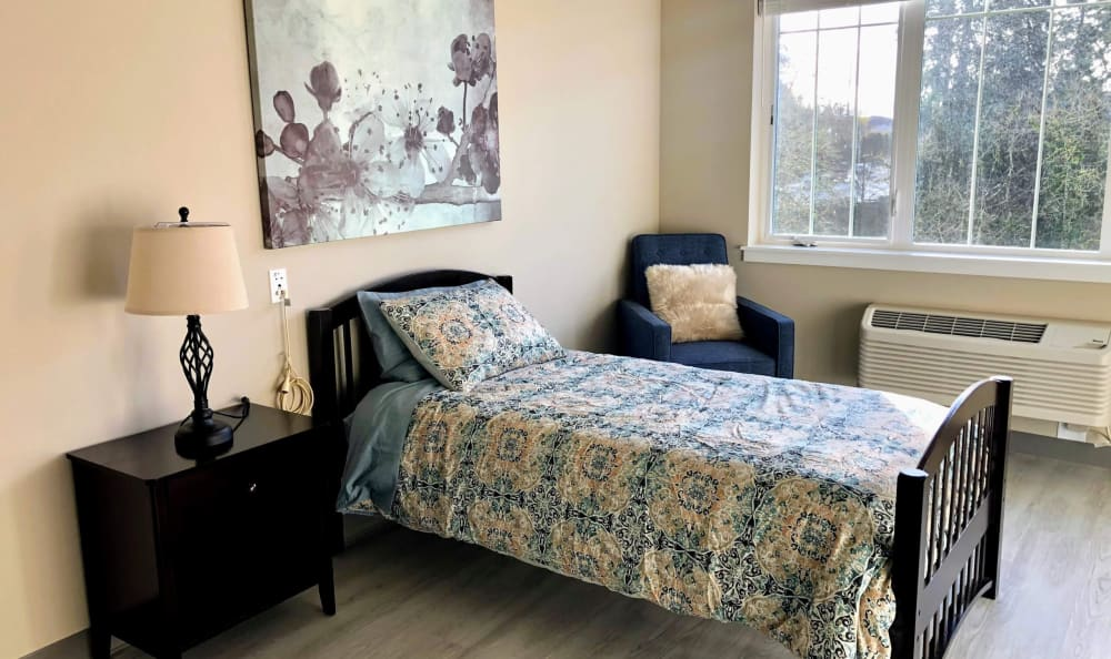 Bedroom in an apartment at HOLI Senior Living in Hillsboro, OR