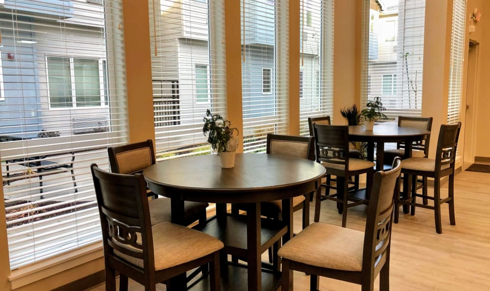 Gather with your friends for a meal at the dining room at HOLI Senior Living in Hillsboro, OR