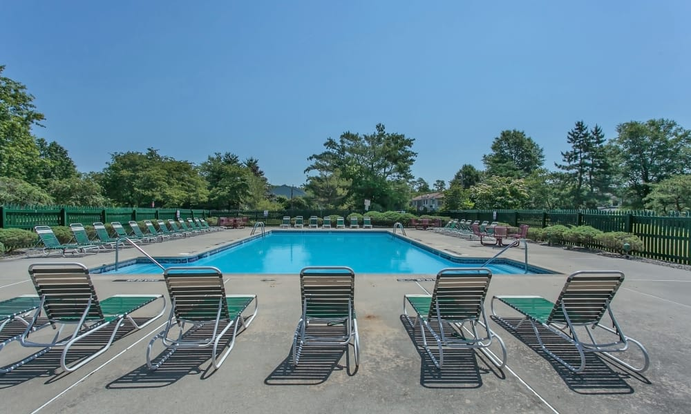 Our apartments in East Brunswick, New Jersey showcase a spacious swimming pool