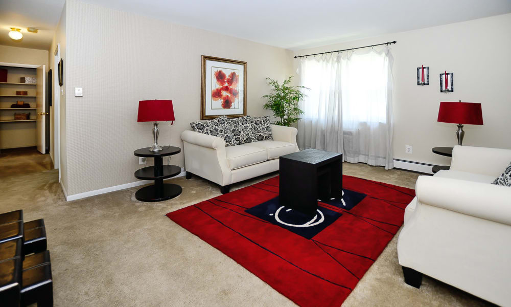 Cozy living room at Roberts Mill Apartments & Townhomes in Maple Shade, New Jersey